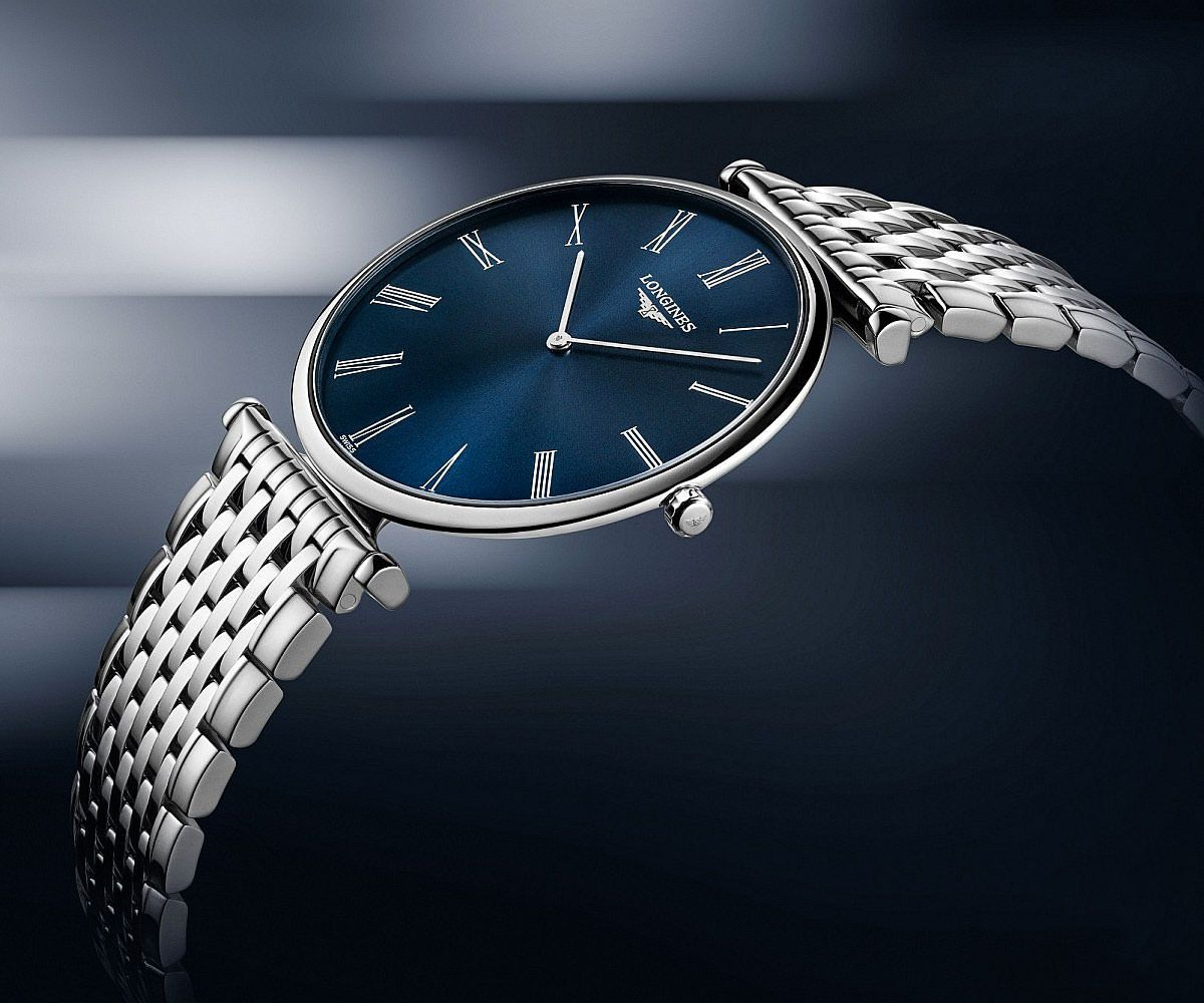 6d73300008a The sunray blue dial laden with painted roman numerals and silvered  polished hands make this quartz watch, offering 30m water resistance, a  timeless wonder